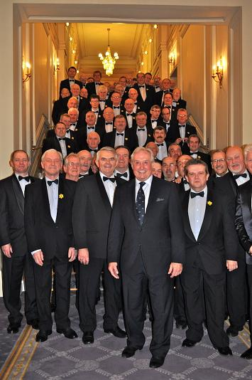 Sir Gareth Evans and choristers at Hotel de Paris